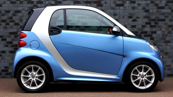 photo of a small blue electric car